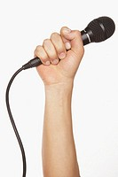Man holding microphone (focus on microphone)