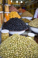 Morocco, Marrakesh, bowls of olives on market stall
