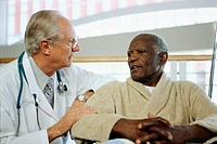 Senior Patient Speaking with Physician