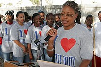 Clean up volunteers, Edison High School students, Black female, local celebrity speaker. Little Haiti. Miami. Florida. USA.