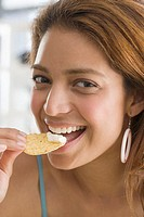 Woman Eating Tortilla Chip