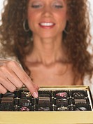 Woman Picking from Box of Chocolates