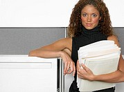 Businesswoman with a Handful of Folders