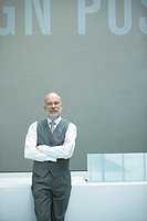 Businessman leaning against front desk