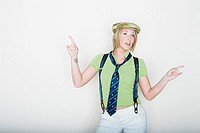 Woman in suspenders pointing with hands