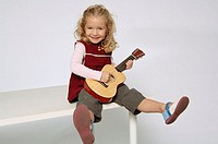 Girl playing with guitar