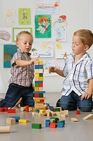 Boys playing with wooden blocks