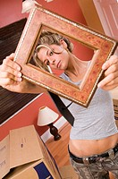 Woman Holding Picture Frame