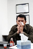 Businessman Blowing His Nose with Cold Medicine