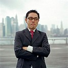 USA, New York City, businessman on riverfront boardwalk