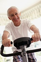 Elderly Man on Exercise Bike