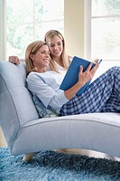 Mother and Daughter Enjoying a Book Together