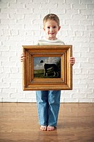 Boy Holding Painting of Dog