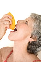 Woman Drinking Juice of an Orange