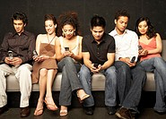 Group of Friends Text Messaging on Cell Phones