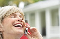 Woman Laughing While Talking on Her Cell Phone