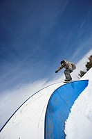 Snowboarder on Railing