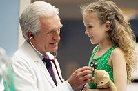 Pediatrician Listening to a Girl´s Heart
