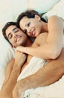 High angle view of a young couple embracing in bed
