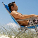 Young Man Relaxing in Beach Chair