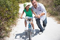 Grandfather Helping Granddaughter Bicycle