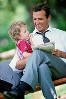Son sitting on his father´s lap