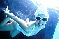 Portrait of a young woman swimming underwater