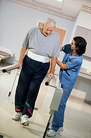 Side profile of a female nurse helping a patient to walk