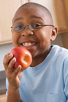 Happy Boy About to Eat an Apple