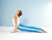 Young woman performing press-ups, side view