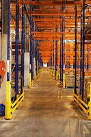 Racks for storing merchandise on pallets in warehouse