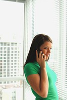 Woman 20 yrs old on telephone at home