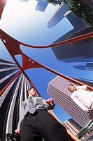 Businessman and woman under modern Los Angeles architecuture
