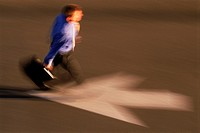 Businessman with briefcase hurrying to work against arrow