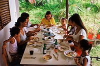 African Creole family eating home cooked meal in Seychelles