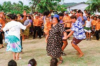 Polynesians dancing playfully to native music on Aitutaki in Cook Islands