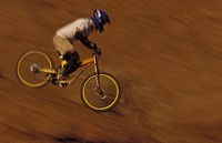 Mountain biker races downhill in a rocky desert