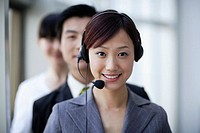 Smiling Businesswoman with Telephone Headset