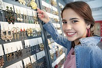 Girl Shopping for Earrings