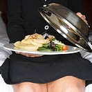 Businesswoman with Meal in Hotel Room