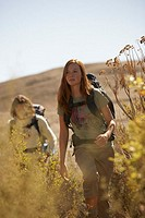 Woman in Front of Boyfriend Hiking through Bushes (thumbnail)