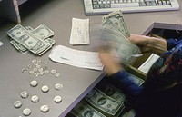 Bank Teller Counting Money