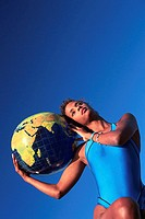 Woman Holding a Globe Beachball