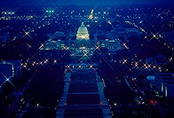 The U.S. Capitol and National Mall at night as seen from the top of the Washington Monument.