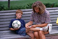 Mother caring for scraped knee, MR