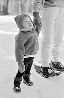 Little girl in snowsuit with mother