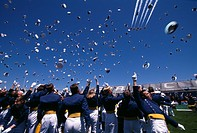 The United States Air Force (USAF) Thunderbirds fly over as USAF Academy Cadets toss their caps in the air at the completion of graduation ceremonies.