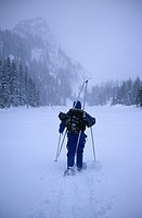 A man snowshoeing in the backcountry during a winter storm, Rocky Mtn Nat´l Park, CO