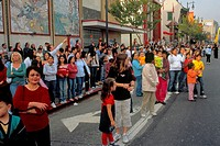 Crowd waiting for the Chinese New Years parade in the Los Angeles Chinatown along Broadway