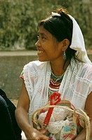 Portrait of smiling young Indian woman in traditional dress at market in Cuetzalan,Puebla State,Mexico.